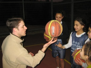 Michael teaching a girl to spin the ball on her finger