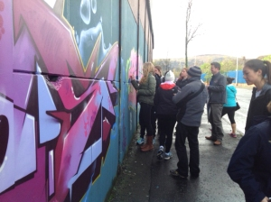 High school students from Sandy Spring visiting a Peace Wall in Belfast