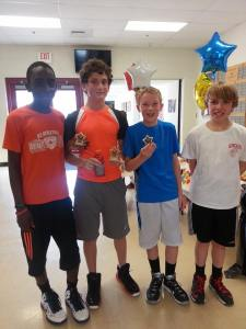 Alex (far right) and his friends with their winning trophies.